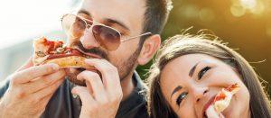Couple Enjoying great pizza in Brampton