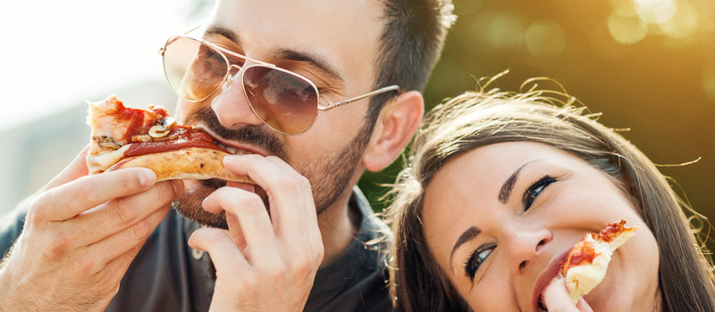 Couple Enjoying great pizza in Brampton